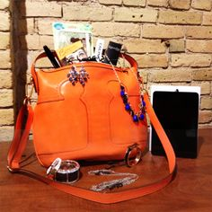Win a Tory Burch bag filled with makeup & accessories, and an iPad mini!