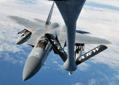 A U.S. Air Force F-15C Eagle finishes refueling a KC-135R Stratotanker in this photo from September 2013. Four F-15s and a KC-135 are headed to Norway for to participate in the Nordic Defence Cooperation exercise.