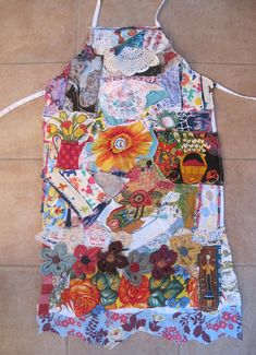 MY BONNY APRON fabrics were used:  flowers embroidery crochet bottle caps chintz Mexican doilies Asian geisha old linens lace Indian vegetables button antique patchwork butterflies dogs trim more flowers African woman eyelet etc (lots here)  2 hand pockets. One Size Fits All.