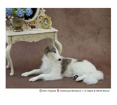 One of my dollhouse miniature 1:12 Borzoi sculptures - handsculpted from polymer clay, wire, paint and dressed in alpaca fiber & flock.