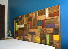 headboard, patchwork, recycled pallet This is by far one of the most original pallet headboard encountered till now. It is made from various kinds of recycled wooden pallet planks, with different sizes, some painted and others used raw. All the planks are assembled in a kind of
