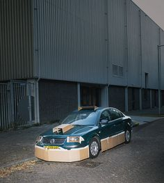 Pimps out strangers cars at night with cardboard and tape / by Max Siedentopf