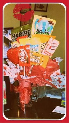 """""""Man bouquet"""" just purchase his favorite goodies and a large mug or vase and craft sticks. Glue sticks to goodies , add tissue paper inside mug fill with favorite mini goodies (I used mini snickers) this will help arrange the sticks the way you want them. Add a bow and there you have your man bouquet. If its in your budget a few gift cards to his favorite places is a nice touch. Just have fun with it ."""