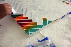 DIY an abstract masterpiece with a masking tape pattern, and then enjoy peeling the strips off one by one.