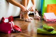 Young woman trying on high heel shoes
