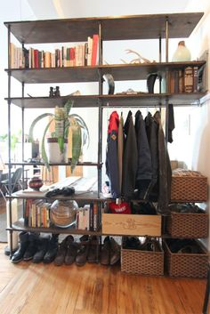 Cool custom built pipe & wood shelf unit —Joey and Antoni's Brooklyn Charmer House Tour | Apartment Therapy
