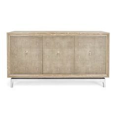 Crafted with ash and veneer solids, a silver-leaf finished base, and faux shagreen door panels with platinum ring pulls. Color and texture play off one another for a mid-century style sideboard with subtle curves. Interior case features a contrasting silver finish and center shelves. Use as a nesting place for tableware or a unique media unit in the living room.