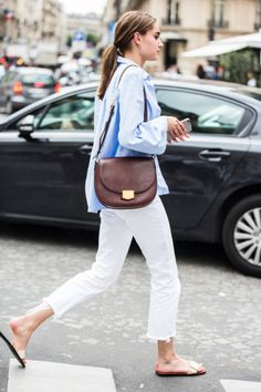 Pale blue shirt, white jeans and tan bag...summer style