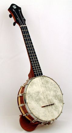 Spanky Ukes - they make beautiful concert scale banjoleles with beautiful inlaid resonators