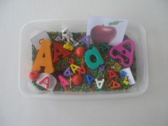 A sensory box  Fill a container with rice or pebbles. Add different forms and shapes of a letter. Fill with objects starting with the same letter.