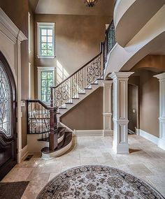 Traditional Staircase with Hardwood floors, Kesir travertine tile - antique pattern sets, Wrought iron railing, Foyer Luxury Staircase, Curved Staircase, Staircase Design, Mansion Interior, Home Interior, Interior Design, Dream Home Design, House Design, Travertine Floors
