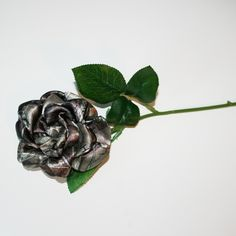 """This long stem HTC camo rose is just what you need for your camo wedding, country wedding. It is about 4 - 4 1/2"""" across, and mounted on a 13"""" rose stem, along with 5 green leaves."""