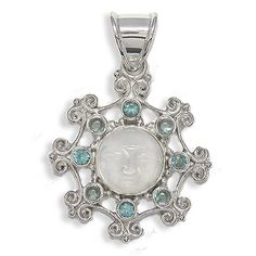 """A round Mother of Pearl goddess is carved and set in Sterling Silver for this sweet pendant. She is adorned with a Sterling Silver and 8 blue gemstones. There are four 3mm Apatite and four 3mm faceted London blue Topaz. Total length including the silver bail is just over 1 1/2""""."""