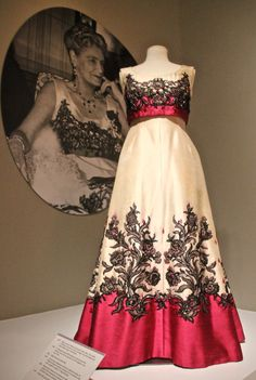 """How would you like to wear this evening gown to the Red Cross Ball? In 1968, Marjorie Merriweather Post did just that. The daughter of General Foods tycoon, C.W. Post may have been born into the middle class, but by the end of her life had collected an impressive array of clothing--and houses. Some of her collection now belongs to the Smithsonian and can be seen in the exhibit """"Ingenue to Icon"""". Don't miss a chance to see #70fasionfilledyears."""