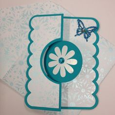 Beautiful teal cardstock, and lightly scented daisy pattern paper from Thailand, create a FLIP-IT card that can be used for any occasion.  It comes with a matching envelope.Free shipping to anywhere in the U.S.* White circle on back of flower for writing your message.
