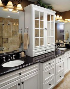 key to a happy marriage! His and Her sinks! :) I'd do a sand color marble instead of black