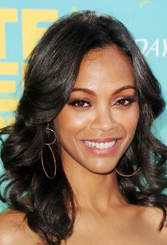 Actress Zoe Saldana arrives at the 2011 Teen Choice Awards held at the Gibson Amphitheatre on August 7, 2011 in Universal City, California.