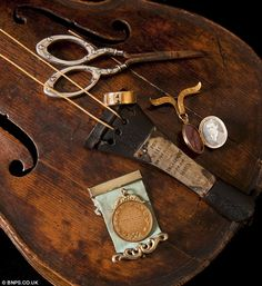 An inscription on the violin (pictured with other artefacts from his life) suggests it was a gift from his fiancée, Maria Robinson