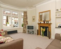 Photo Of Victorian Style Beige White Living Room Lounge With Low Radiator Mirror Fireplace And Sofas