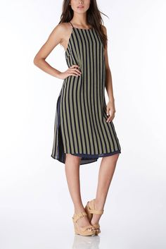 A pretty dress perfect for any relaxed occasion from beach side lounging to date night events. #trendy