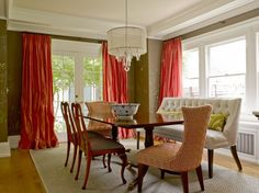 Salmon pink silk curtains covering French doors, chocolate brown walls paint color, ivory tufted dining settee and Philip Gorrivan Greek Key Fabric in Tomato upholstered captain chairs. Dining Room Sets, Dining Room Design, Dining Chairs, Side Chairs, Dining Table, Seattle, Brown Walls, Black Walls, Interior Design Magazine