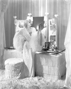 """Eleven is the exact number of shades used by art directors Hobe Erwin and Frederic Hope for MGM's film Dinner at Eight (1933). One of the first true films to chronicle the art of social climbing, director George Cukor.The thirties sets were significant as it marked a time in Hollywood film design known as the BWS - Big White Set. Also coined the """"polar bear"""" or """"white telephone look"""", white was the dominant color."""