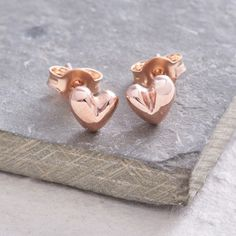 Sweetheart Rose Gold Stud Earrings    Our handmade solid gold heart 'Sweetheart' earrings are feminine and classy - the perfect pair of handmade gold heart studs. The gold hearts are individually cast with a tactile organic and symmetrical shape.  This is an original Scarlett Jewellery design that's been a popular and well loved design for many years. Team them with the matching gold heart bangle and Sweetheart gold necklace to complete your look.