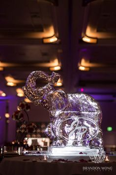Amazing ice sculpture with the couple's initials etched into it