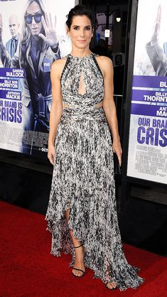 SANDRA BULLOCK in a printed halter neck J.Mendel gown at the premiere of Our Brand is Crisis in L.A. Jason LaVeris/FilmMagic Updated: Tuesday Oct 27, 2015 | 11:37 AM EDT Copyright © 2015 Time Inc. All rights reserved. Reproduction in whole or in part without permission is prohibited.