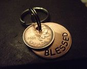 Lucky Us Copper Keychain with two lucky pennies     The squared version. $18.00, via Etsy.