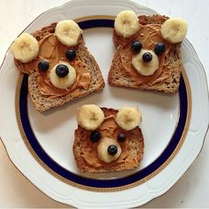 Peanut butter banana bear toasts...toasted wheat bread spread with creamy peanut butter(or almond butter), banana slices and blueberries for eyes and ears