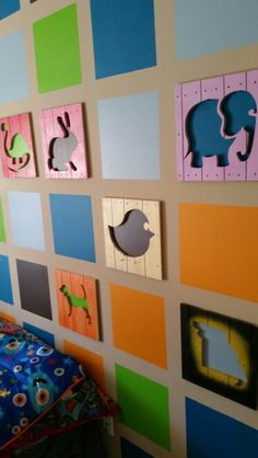 Faux wood panel animal silhouettes. Painted wall behind gives each one its color