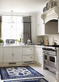 There is nothing I love more than a classic white kitchen . except for a classic white kitchen with blue and white accessories! We recentl. Cosy Kitchen, Kitchen Ideas, Kitchen Rug, Blue Kitchen Decor, Kitchen Backsplash, Vintage Kitchen, White Kitchen Floor, Dutch Kitchen, Kitchen Black