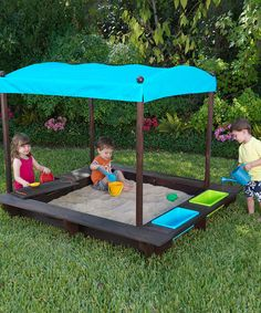 Kona Sandbox with Canopy, plastic tubs for water, hidden compartment for sand toys, and the edge all the way around is a place to sit.Could easily make this one!