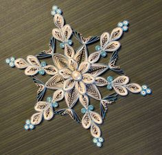 Quilled Snowflake Ornament by HeirloomQuilling on Etsy https://www.etsy.com/listing/253929031/quilled-snowflake-ornament