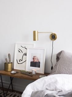 How to Display Art Without Putting Holes in the Wall. These renter friendly decorating ideas are perfect for decorating small spaces without damaging the walls Home Bedroom, Bedroom Decor, Bedroom Lighting, Bedroom Wall, Bedroom Ideas, Master Bedroom, Arty Bedroom, Bedside Lighting, House Lighting