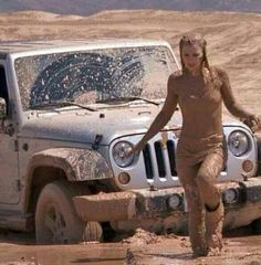 I think she likes the mud! Cause I doubt that jeeps stuck! DGJ*