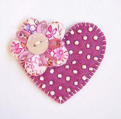 Cute pin idea.  Would also be cool with yo-yo flowers