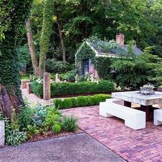 """Design trend for 2017: Old and new mash-up. """"It used to not be OK to mix styles, but now it's acceptable."""" says Richard Hartlage of @landmorphology. Pictured: A modern table with bench seating offers a bold contrast to the traditional brick architecture of the outbuilding and brick patio. See more trends on gardendesign.com now! Photo by: @robcardillophoto  #gardendesign #gardentrend #designtrend #gardening #oldandnew #architecture #landscapedesign #gardeninspiration"""