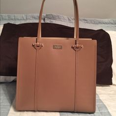 """Kate Spade Arbour Hill Elodie Brand new with tags detached!  Gorgeous large Elodie in a beautiful tan color.   Exterior: Dark Beige Interior: Light Beige 1 Slip Pocket 1 Zip Pocket Open Face Bag Includes Original Dust Bag Gold Tone Hardware  12""""x6""""x13"""". 9"""" strap drop.   NO TRADES AND NO OFFERS IN COMMENTS  kate spade Bags Shoulder Bags"""