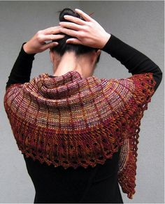 This shawl uses a swing knitting technique, which allows for a colour change on every row of the work, as well as a stocking stitch/slip stitch pattern throughout the body of the shawl and a knit on lace edging.
