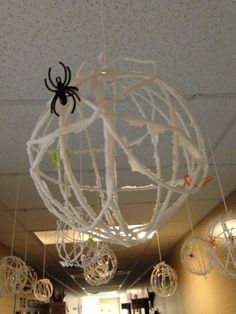 Spider Web Globe - yarn, glue, & corn starch... wrapped around a balloon. Allowed to dry. Balloon popped. Spiders Added. Voila! #Preschool Halloween Craft. / Globes in picture were done by my Co-Worker's 4yr old class... Challenging at first, but wonderful turn out.