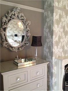 An inspirational image from Farrow and Ball: The drawers and mirror were painted in Elephants Breath eggshell to match the woodwork. Adding new handles and a glass top to the drawers, and a hand made silk lamp shade, finished it all off.