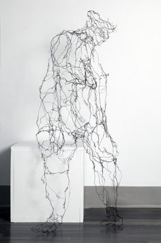 """Sculptures « Naomi Grossman - 'My wire sculptures and mixed media installation pieces reference the female form and become drawings in space. The wires change in thickness as a drawn line might. Words like thoughts appear. The wire creates a tension- """"wired""""- while also conveying both strength and fragility. Wire figures are suspended in space, clinging to walls, sitting, crouching, appearing and disappearing; secrets are whispered, fears revealed. The viewer is eavesdropping on someone's…"""