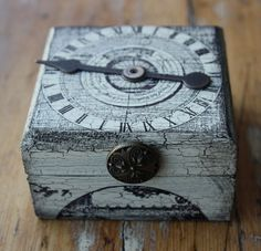 Steampunk Trinket Box. Decorated in a shabby chic manner using paint and inks to give it an aged and distressed appearance. reclaimed vintage button attached to the front of the lid as a faux knob. Made of quality wood with a hinged, magnetic lid. Size 6cm x 6cm x 3.5cm.
