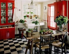 I've always associated black and white tiles with ice cream parlors...now this is a cute way to include them into the home.