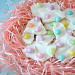 Jelly Bean Bark -   2 cups of white chocolate chunks  1 cup Easter egg jelly beans  ■Line a baking sheet with parchment paper.■  Melt the chocolate chunks, use a double boiler, or a saucepan and a metal or glass bowl.  Put the chocolate into the empty bowl,stir it until melted.■Spread melted chocolate on to the parchment paper, about 1/4 inch thick.■Let cool for a few minutes, sprinkle on your jelly beans. Allow the chocolate to cool completely, before breaking it into pieces.