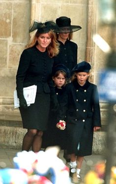 Sarah, Duchess of York with her daughters Princess Beatrice of York and Princess Eugenie of York at the funeral of Diana, Princess of Wales (1961-1997).