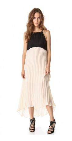 COLORBLOCK DRESS $91.90 SPECIAL $42.35 YOU SAVE: 54% Accordion pleats work in tandem with the breezy, uneven hem on this two-tone dress. Tie closure in back. Mini dress lining.
