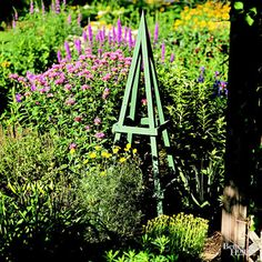 Create a year-round garden accent with this stylish plant obelisk. Whether supporting vines or left unadorned, it adds a vertical design element to your garden.